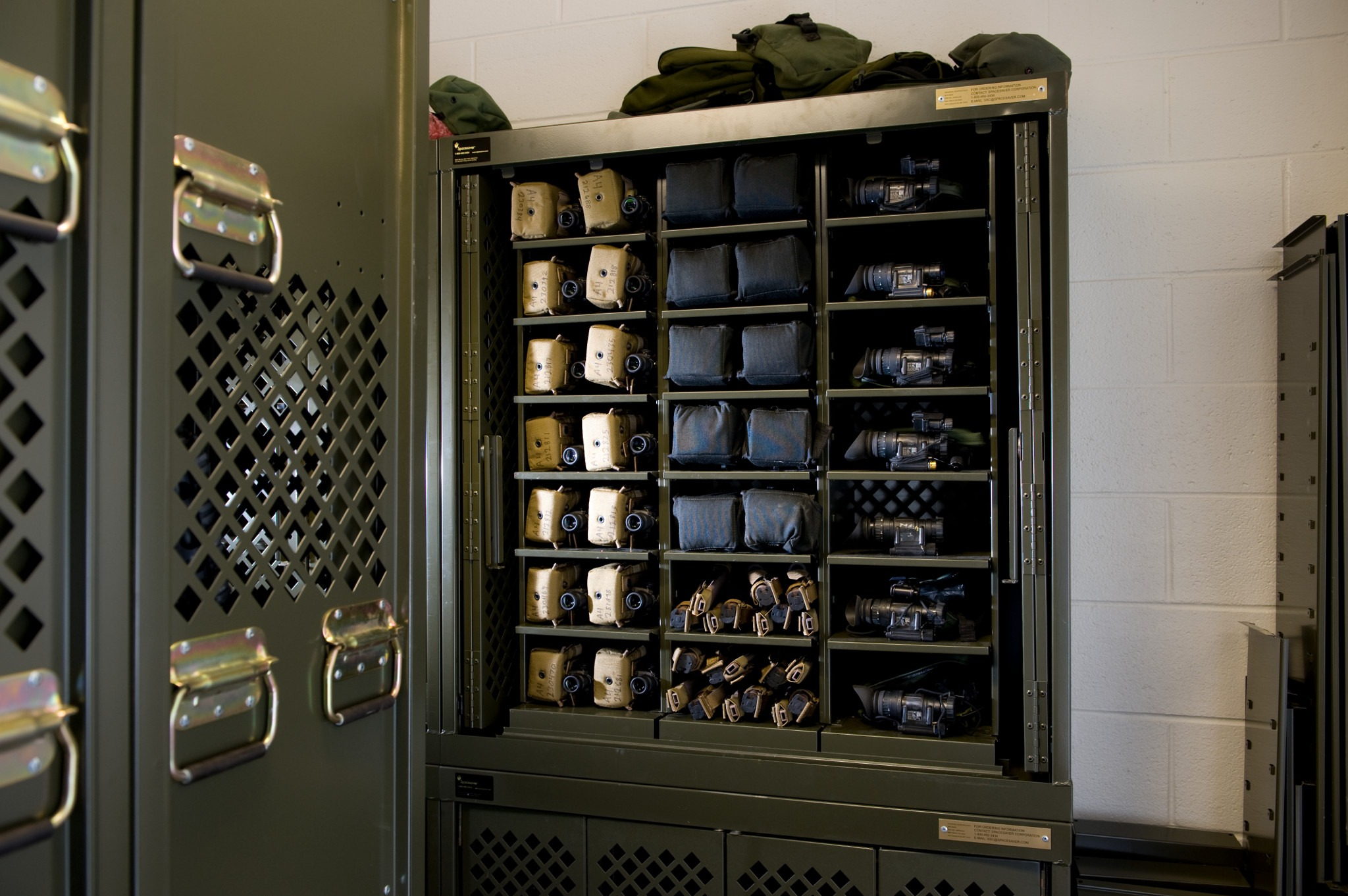 Military Storage - compact mobile shelving to define the room space