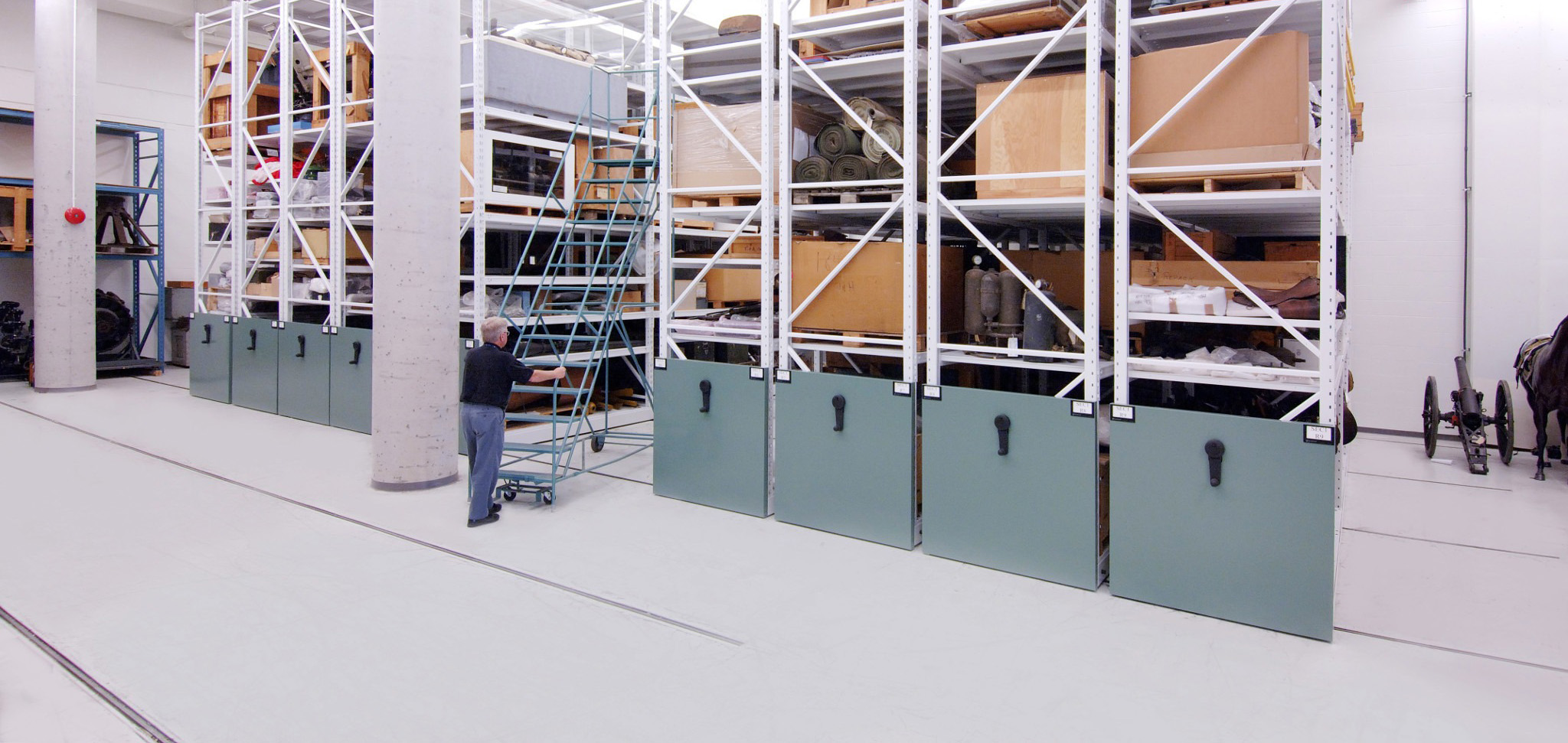 Wide span shelving on mechanical assist mobile for museum archival storage