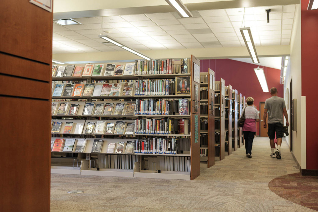 Library Storage - cantilever shelving with custom end panels at Uintah County Library
