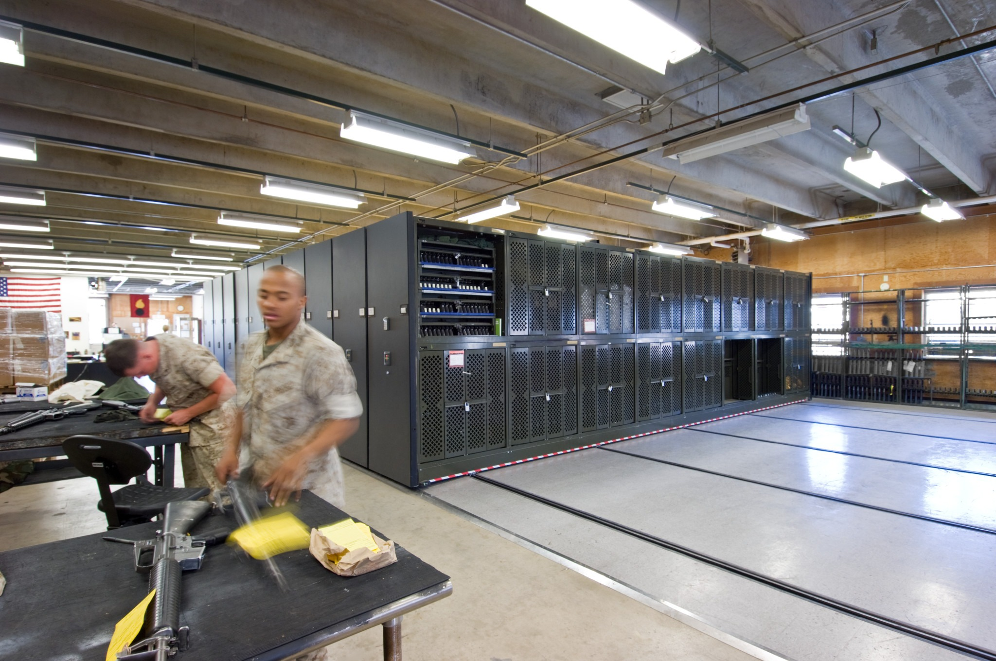 Military Storage - Weapons racks on compact mobile storage systems