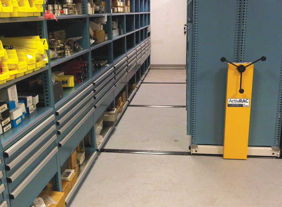 Maintenance part storage in metal shelving on compact storage system