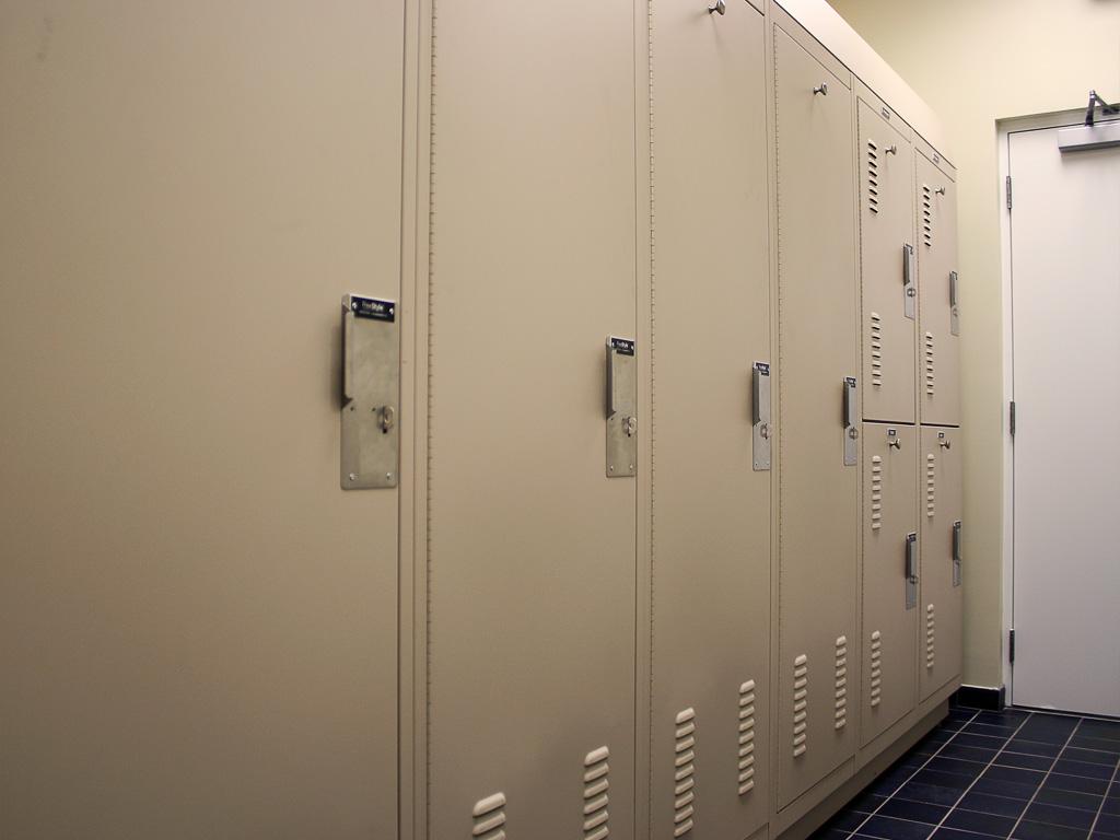 Hasp lock gear lockers in Police Department locker room
