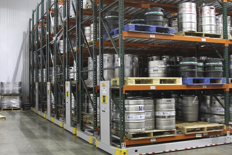 Different size kegs stored on warehouse mobilized racking system