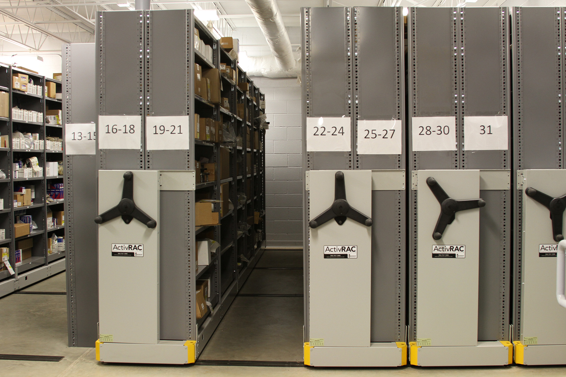 Tool room storage on mechanical-assist mobile shelving