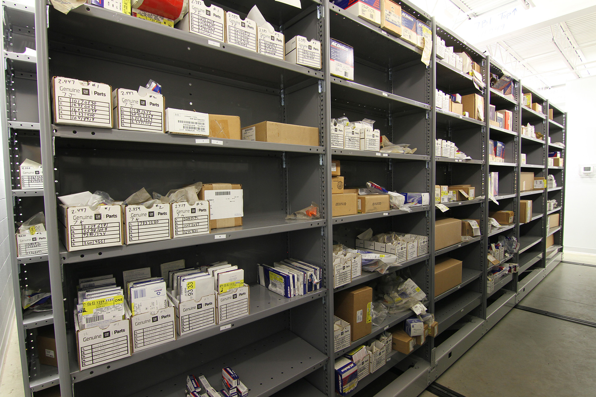 Service department storage on metal compact shelving