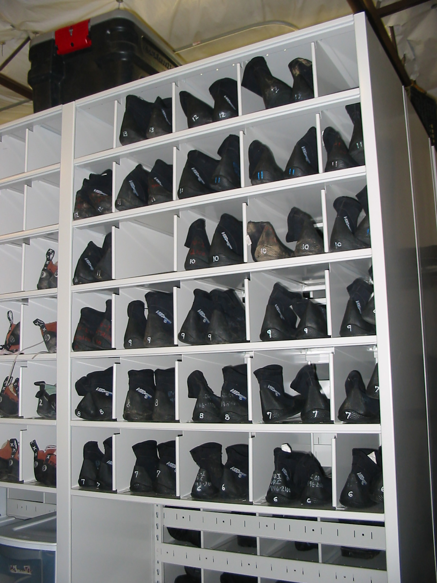 Shoe rental in bins on mobile storage system at Brigham Young University Outdoor Resource Center