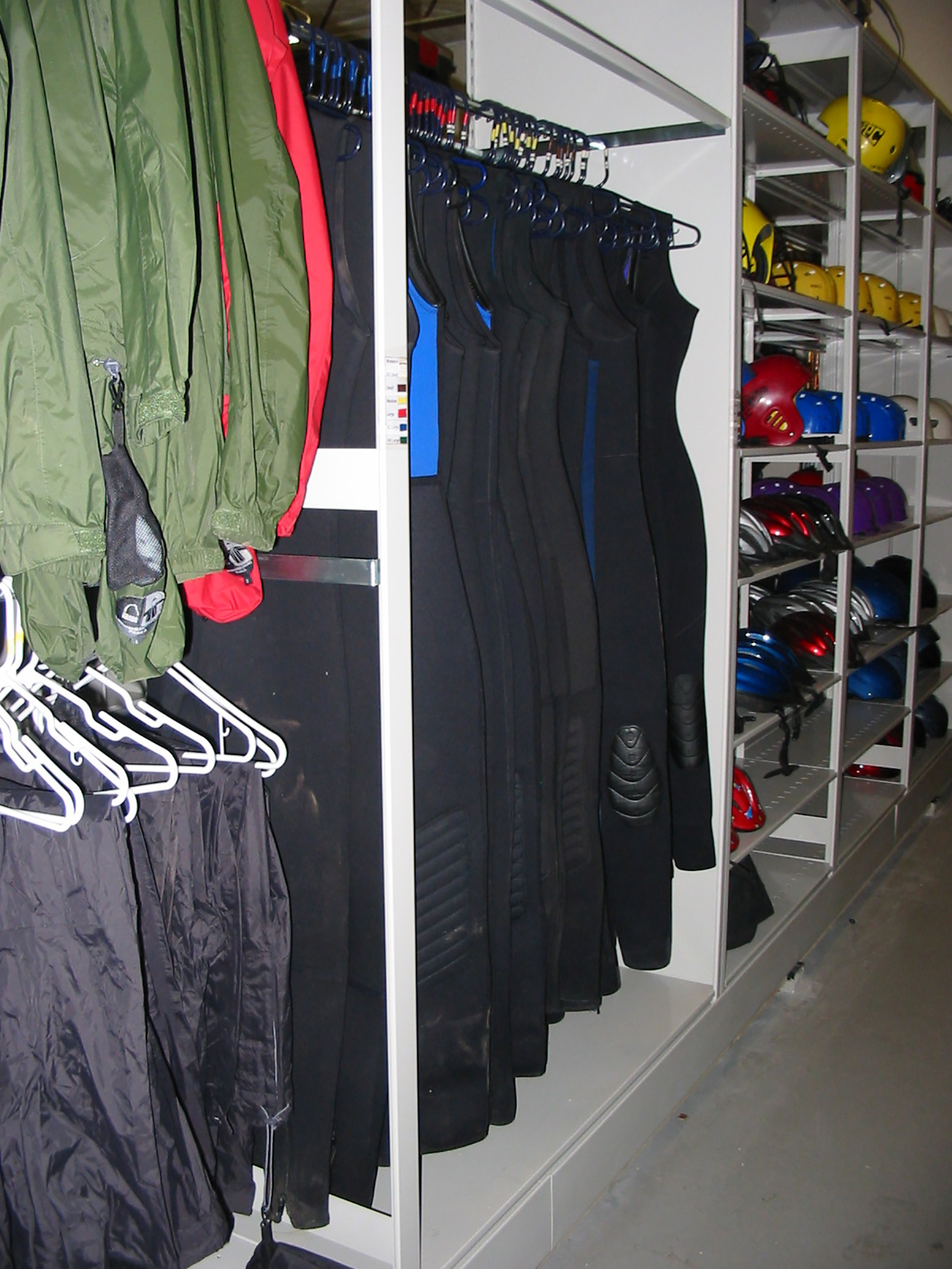 Kayaking apparel and equipment storage on hanging shelving at Brigham Young University Outdoor Resource Center