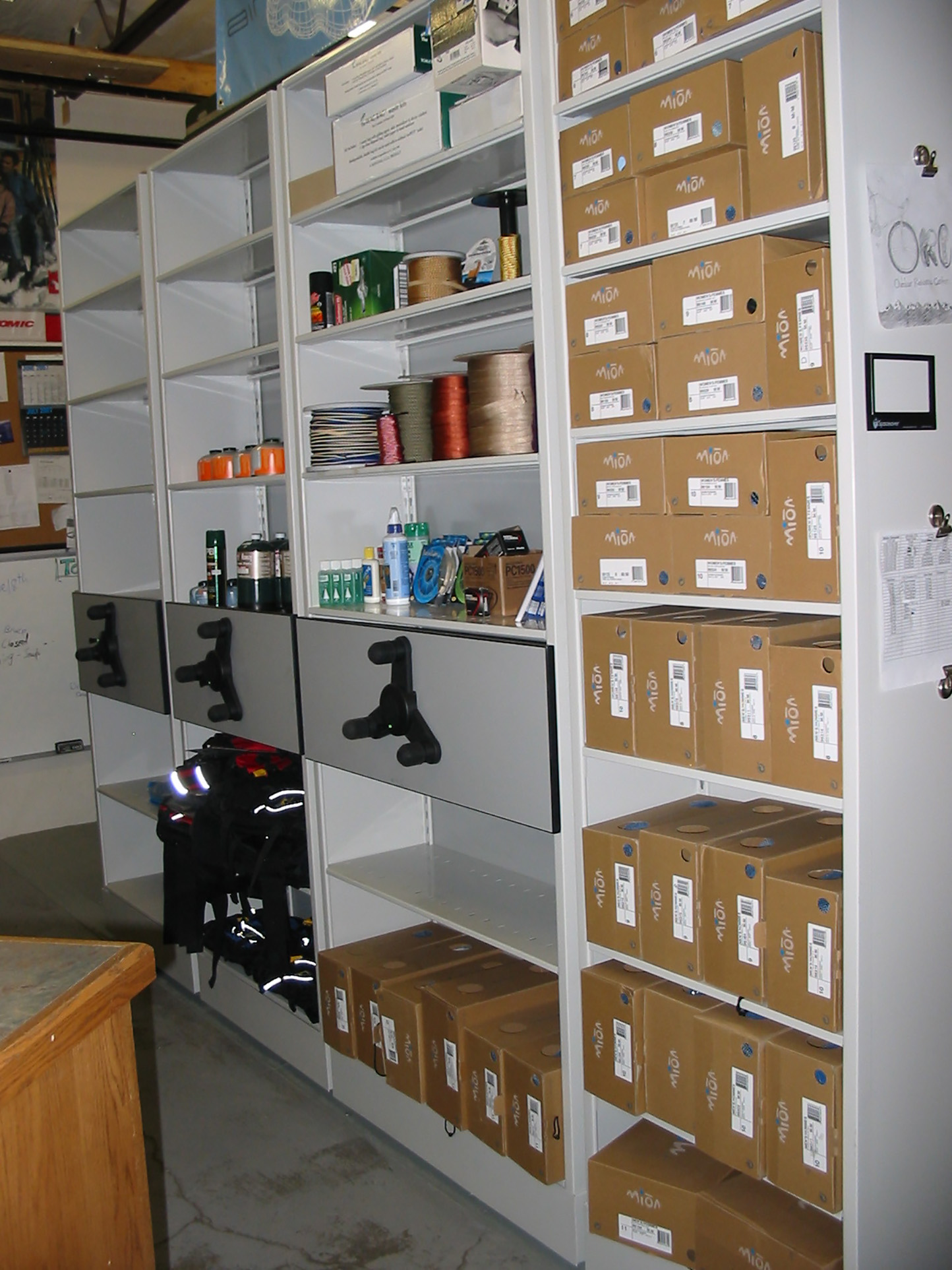 High-density mobile storage system with shelving end caps at Brigham University