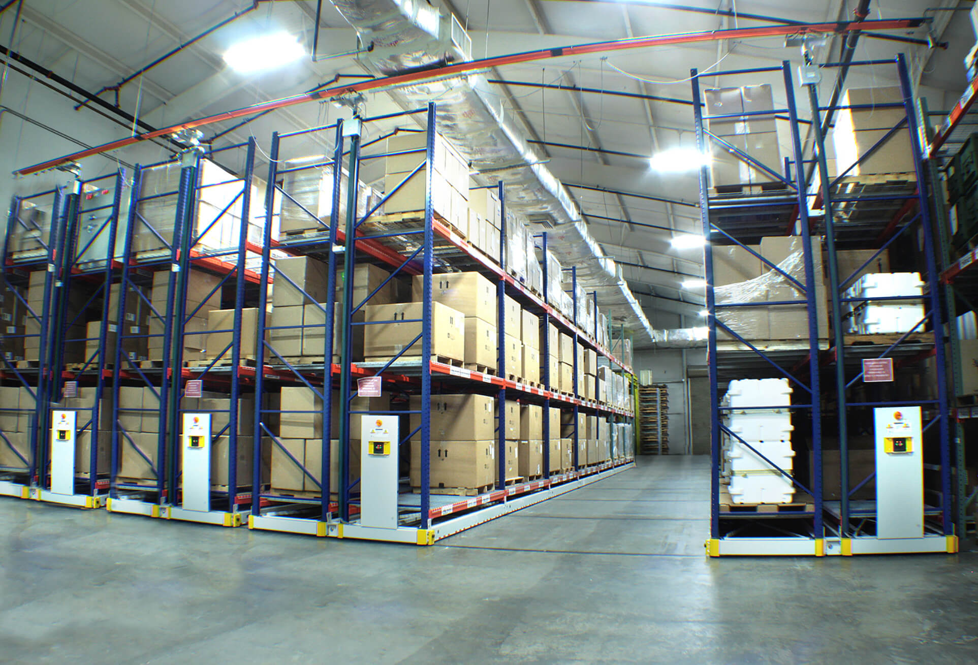Warehouse materials stored on powered compact racking system
