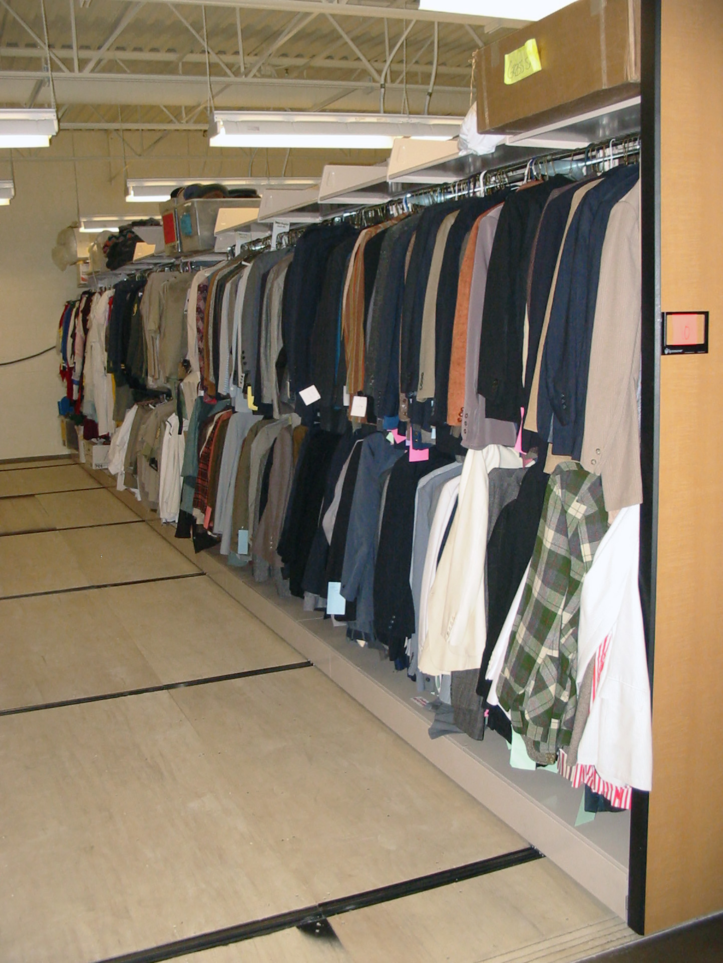 Two tiers of hanging storage for costumes at Brigham Young University Performing Arts Center