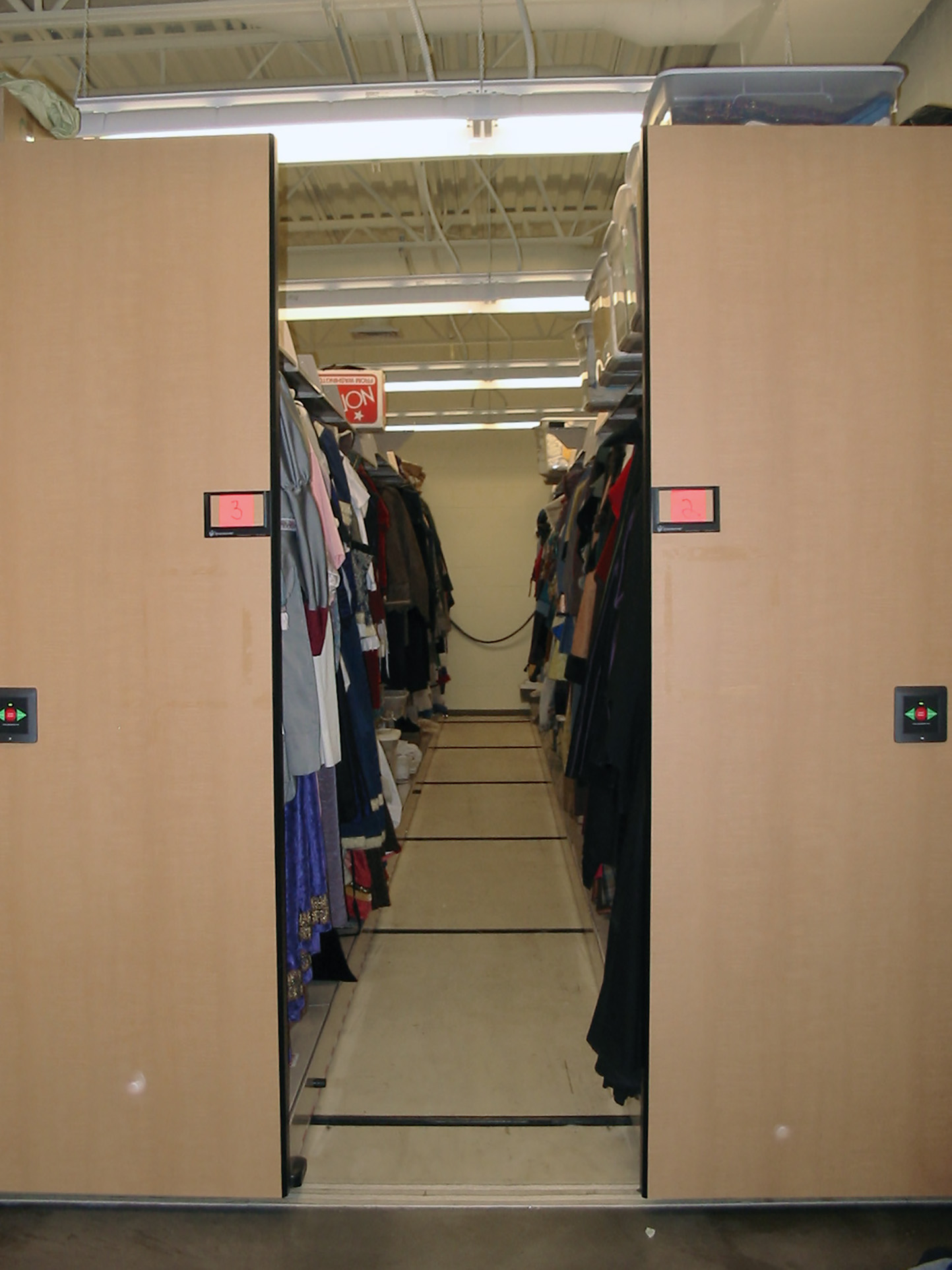 Powered compact mobile storage for costumes and props at Brigham Young University Performing Arts Center