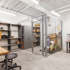 wire caging with cabinets and workbenches